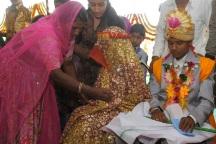 A relative comforts a bride