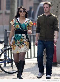 Mark Zuckerberg and Priscilla Chan walk