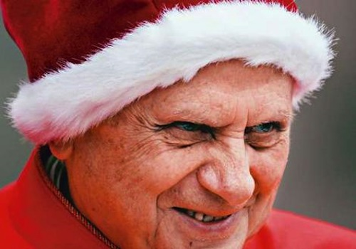 Pope Benedict looking lovely with his Santa hat